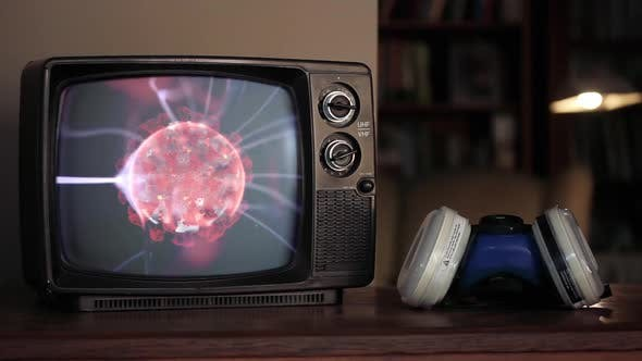 Thumbnail for Plasma Globe with COVID-19 on a Retro TV and a Man picking up Mask.