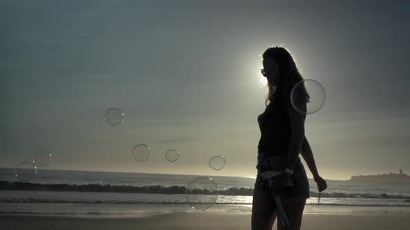 Girl Making Bubbles