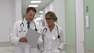 Healthcare Professionals Walking together in Hospital