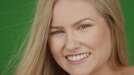 Thumbnail for Closeup of beautiful young woman smiling for the camera on green screen