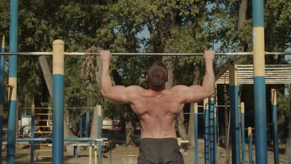 Thumbnail for Athletic Man Making Pull-up Exercises on Crossbar