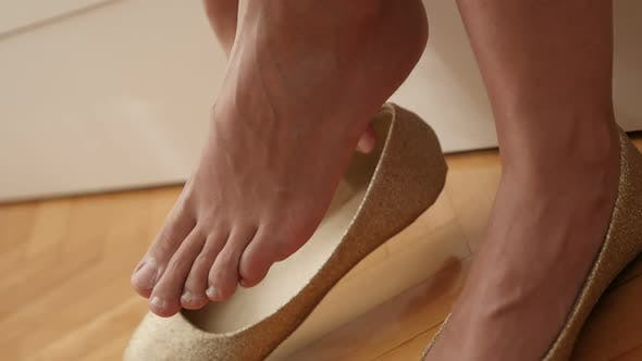 Thumbnail for Try-out of  elegant evening shoes slow-mo 1920X1080 HD footage - Trying of golden colour ballet flat