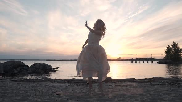 Thumbnail for Beautiful Girl Dancing at Sunset on the Shore