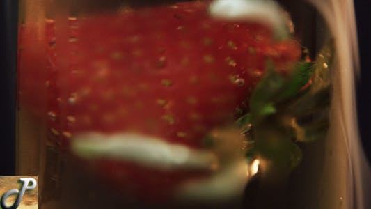 Thumbnail for Rotating Strawberry In Champagne