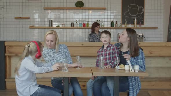 Single Women with Kids Spending Leisure in Cafe