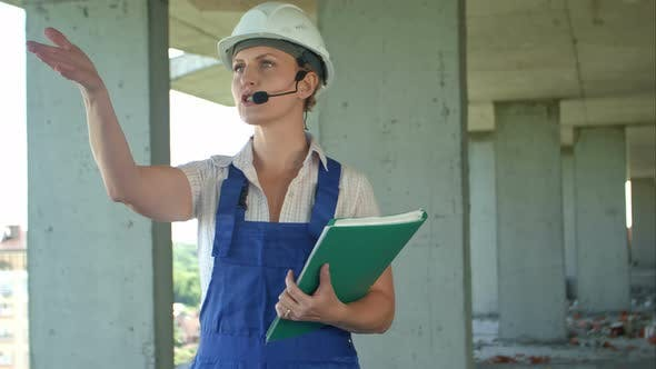 Thumbnail for Female Construction Engineer Talk To Workers Through Internal Links