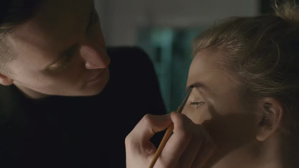 Thumbnail for Makeup Artist Filling In Eyebrows