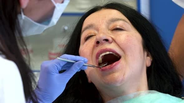 Dentist Checks Up Woman's Teeth