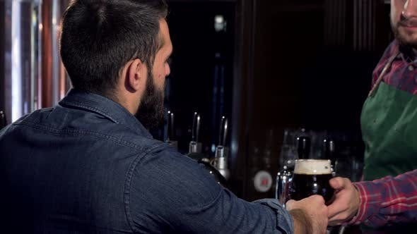 Thumbnail for Unrecognizable Man Drinking Delicious Craft Beer at the Pub