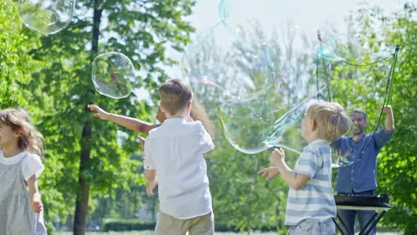 Thumbnail for Kids at Soap Bubbles Party in Park