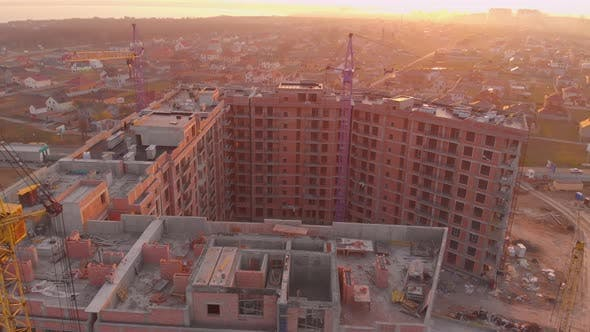 Thumbnail for Construction Site in the Middle of the City and Private Houses at Sunset in .