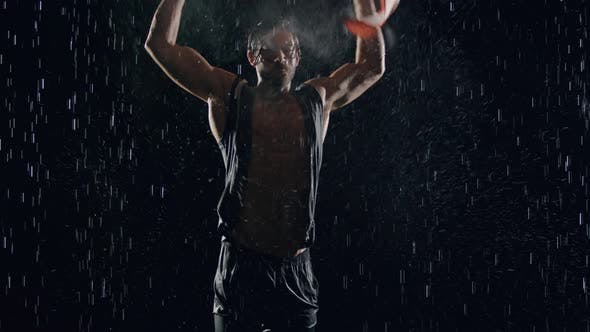 Thumbnail for Victorious Man In The Rain With American Flag