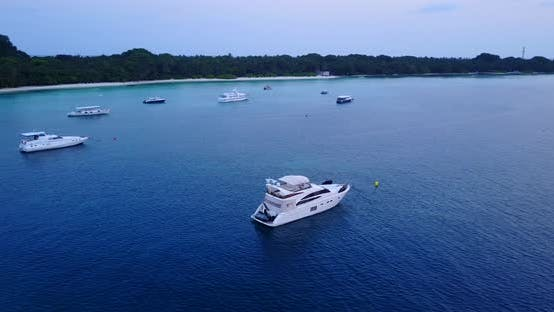 Luxury drone island view of a white sandy paradise beach and aqua blue water background in colourful