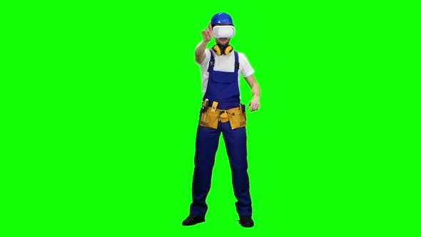 Thumbnail for Worker in a Helmet and in Glasses of Virtual Reality. Green Screen