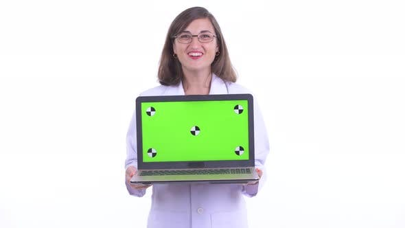Thumbnail for Happy Beautiful Woman Doctor Showing Laptop and Looking Surprised