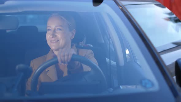Cover Image for Joyful Mom Taking Girl Home After School By Car