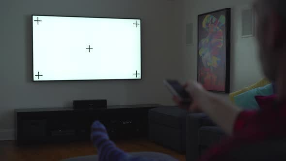 Thumbnail for A Man Makes Use of a TV remote
