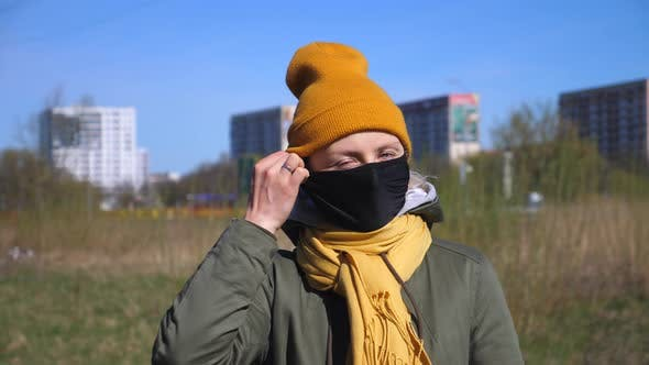 Thumbnail for Woman Taking Off Her Face Mask. End Of Coronavirus Quarantine.