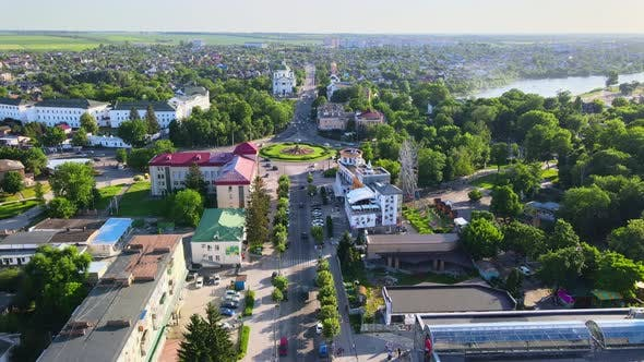 Thumbnail for Drone Fly Above Road at Small European City in Sunny Summer Day