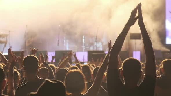 Thumbnail for Crowd of Fans at Live Rock Concert Raise Hands and Dance. Slow Motion 240 Fps