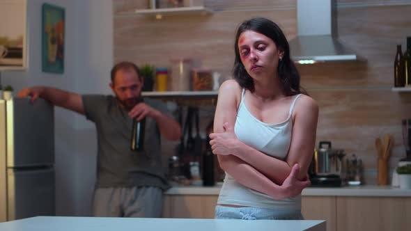 Beaten Woman Trembling of Pain