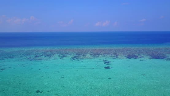 Thumbnail for Daytime drone tourism shot of a white paradise beach and aqua blue ocean background