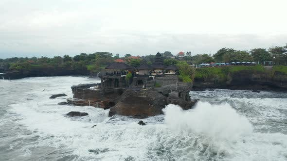 Aerial Rotating Shot of Empty Tanah Lot Temple During the Storm in Bali Indonesia
