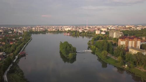 Aerial view of big lake and an island in the center of Ivano-Frankivsk city, Ukraine.
