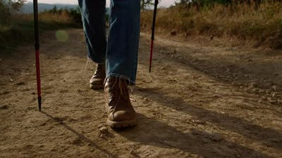 Man in Hiking Boots Walking on Dirt Road