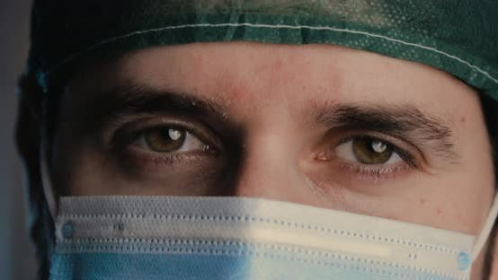 Thumbnail for Eyes of a male doctor saying yes with Head