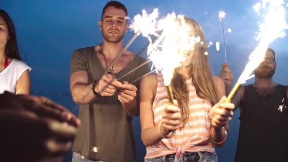Thumbnail for Happy Young Friends with Sparklers