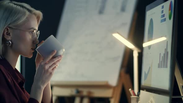 Thumbnail for Concentrated Business Woman Drinking Coffee Front Computer in Night Office