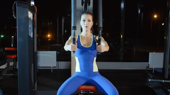 Thumbnail for Female Athlete Training Hands and Shoulders on Weights Machine in Gym Women