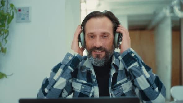 Senior Adult Man Listen To Music in Headphones