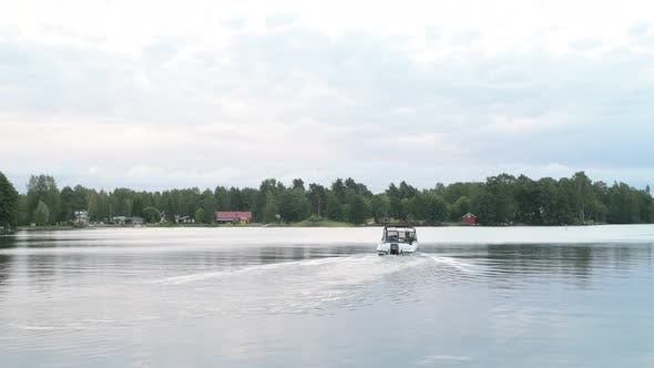 Cover Image for Motorboat Cruising In The Lake Against View Of Nature