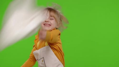 Funny Child Girl Kid Dressed Cook Chef Baker in Apron and Hat Dancing Fooling Around Making Faces