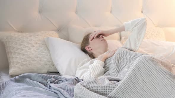 Thumbnail for Sick Young Woman Coughing while Sleeping in Bed