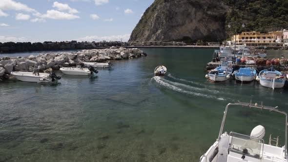 Thumbnail for Motorboat Leaving Sant Angelo Port, View of Parked Boats and Yachts, Italy
