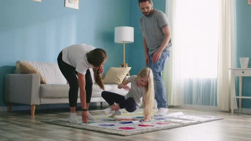 Family Plays Twister