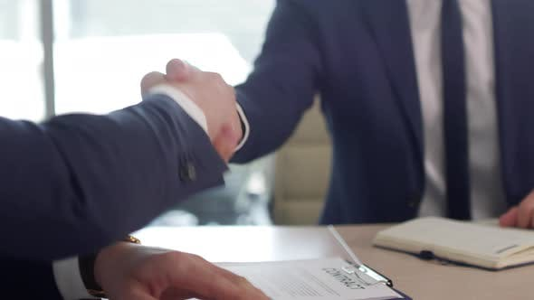 Thumbnail for Unrecognizable Business Partners Shaking Hands