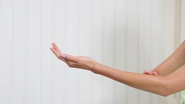 Girl Rubs Hand Cream, Makes a Hand Massage