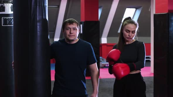 Thumbnail for Woman and Man in the Gym Are Going To Train the Boxing