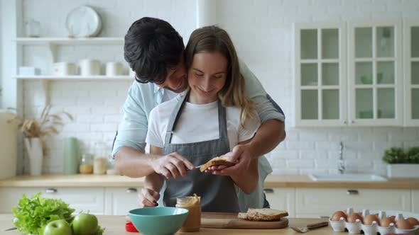 Thumbnail for Closeup Happy Couple Cooking Together at Home. Beautiful Man and Woman Having Fun. A Young Couple