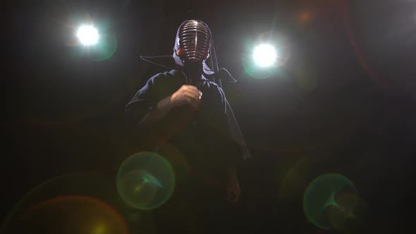 Athletic Kendo Instructor Is Posing for the Camera in Twilight.