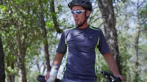 Thumbnail for Mountain biker takes a water break