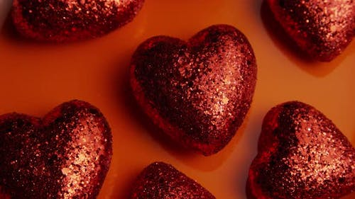 Rotating stock footage shot of Valentines decorations and candies - VALENTINES 0034