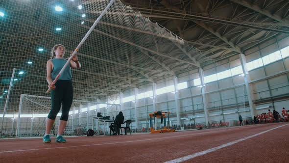 Thumbnail for Pole Vaulting - the Sportswoman Is Configuring To Jump and Running