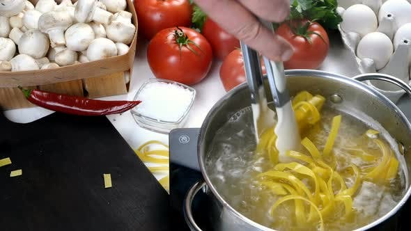 Chef Cooking Pasta in Saucepan