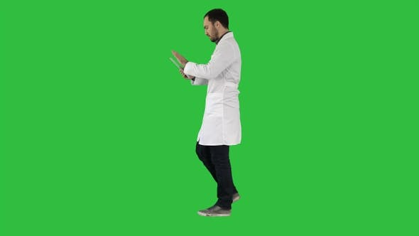 Thumbnail for Doctor using tab while walking on a Green Screen, Chroma Key.