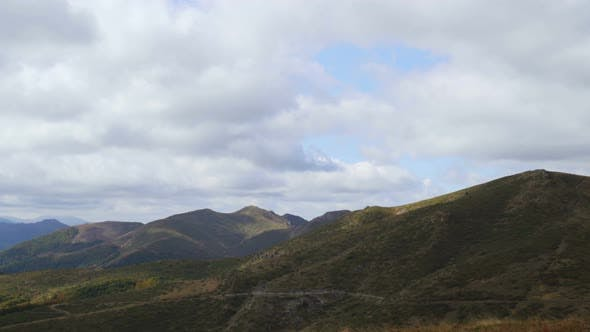 Thumbnail for Green Mountain Pastures Panoramic Vista of Hills with Big White Fluffy Clouds in the Sky